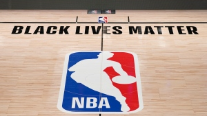 Black Lives Matter is displayed near the NBA logo in an empty basketball arena Friday, Aug. 28, 2020, in Lake Buena Vista, Fla. (AP Photo/Ashley Landis, Pool)