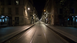 An empty street is pictured after curfew in Marseille, southern France, Sat, Oct. 24, 2020. The curfew imposed in eight regions of France last week, including Paris and its suburbs, is being extended to 38 more regions and Polynesia. (AP Photo/Daniel Cole)