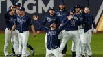 Tampa Bay Rays celebrate their win against the Los Angeles Dodgers in Game 4 of the baseball World Series Saturday, Oct. 24, 2020, in Arlington, Texas. Rays defeated the Dodgers 8-7 to tie the series 2-2 games. (AP Photo/Eric Gay)