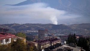 Smoke rises after shelling by Azerbaijan's artillery during a military conflict in Stepanakert, the separatist region of Nagorno-Karabakh, Saturday, Oct. 24, 2020. The heavy shelling forced residents of Stepanakert, the regional capital of Nagorno-Karabakh, into shelters, as emergency teams rushed to extinguish fires. Nagorno-Karabakh authorities said other towns in the region were also targeted by Azerbaijani artillery fire. (AP Photo)