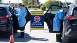 Paramedics administer nasal swabs at a drive through, pop-up COVID-19 test centre outside the Canadian Tire Centre, home of the NHL's Ottawa Senators, in Ottawa, Sunday, Sept. 20, 2020. THE CANADIAN PRESS/Justin Tang