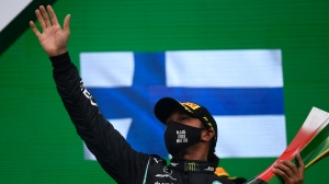 Mercedes driver Lewis Hamilton of Britain celebrates after winning the Formula One Portuguese Grand Prix at the Algarve International Circuit in Portimao, Portugal, Sunday, Oct. 25, 2020. (Rudy Carezzevoli, Pool via AP)