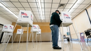 FILE - In this Oct. 20, 2020, file photo, Kelly Wingfield, of Urbandale, Iowa, fills out his ballot during early voting for the general election in Adel, Iowa. (AP Photo/Charlie Neibergall, File)