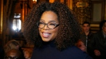 "FILE - Oprah Winfrey arrives for the presentation of Stella McCartney's ready-to-wear Fall-Winter 2019-2020 fashion collection in Paris on March 4, 2019. Winfrey is setting aside her usual book club recommendations and instead citing seven personal favorites ranging from James Baldwin's landmark essays in ""The Fire Next Time"" to Mary Oliver's poetry collection ""Devotions."" She is calling her choices ""The Books That See Me Through,"" works she values for ""their ability to comfort, inspire, and enlighten"" her. (AP Photo/Michel Euler, File)"