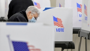 Voters fill out their ballots at the Washington County Election Center in Hagerstown, Md., Monday, Oct. 26, 2020, on the first day of in-person early voting. (Colleen McGrath/The Herald-Mail via AP)