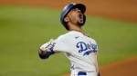 Los Angeles Dodgers' Mookie Betts celebrates after a home run against the Tampa Bay Rays during the eighth inning in Game 6 of the baseball World Series Tuesday, Oct. 27, 2020, in Arlington, Texas. (AP Photo/Eric Gay)