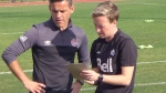Coach John Herdman, centre, prepares for practice with Bev Priestman, a member of his coaching staff, ahead of Sunday's soccer game against the United States in the final of the CONCACAF Women's Olympic Qualifying Championship, in Houston, TX, on Saturday, Feb. 20, 2016. Priestman, Canada's new women's soccer coach, is looking for bravery on and off the field. (THE CANADIAN PRESS/Neil Davidson)