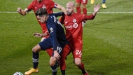 New York City FC's Jesús Medina controls the ball as Toronto FC's Michael Bradley, back left, and Laurent Ciman defend during the first half of an MLS soccer match Wednesday, Oct. 28, 2020, in East Hartford, Conn. (AP Photo/Jessica Hill)
