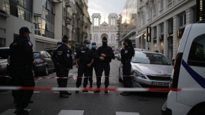Police patrol on a street outside the Notre Dame church in Nice, southern France, after a knife attack took place on Thursday, Oct. 29, 2020. An attacker armed with a knife killed at least three people at a church in the Mediterranean city of Nice, prompting the prime minister to announce that France was raising its security alert status to the highest level. (AP Photo/Daniel Cole)