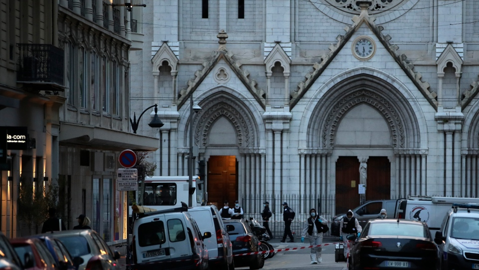 Police and forensics workers leave the Notre Dame church in Nice, southern France, after a knife attack took place on Thursday, Oct. 29, 2020. An attacker armed with a knife killed at least three people at a church in the Mediterranean city of Nice, prompting the prime minister to announce that France was raising its security alert status to the highest level. (AP Photo/Daniel Cole)