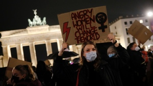 A woman from Poland shows a poster as she attends a protest against recent tightening of Poland's restrictive abortion law, in front of the Brandenburg Gate in Berlin, Germany, Thursday, Oct. 29, 2020. (Photo/Markus Schreiber)