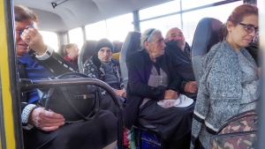 People sit in a bus as they prepare to leave Stepanakert, the separatist region of Nagorno-Karabakh, Friday, Oct. 30, 2020. (AP Photo)