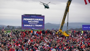 Marine One helictopter, with President Donald Trump aboard, lands at the Altoona-Blair County Airport in Martinsburg, Pa, Monday, Oct. 26, 2020, for a campaign rally. (AP Photo/Gene J. Puskar)