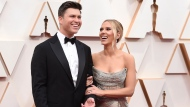 In this Feb. 9, 2020 file photo, Colin Jost, left, and Scarlett Johansson arrive at the Oscars in Los Angeles. (Photo by Jordan Strauss/Invision/AP, File)