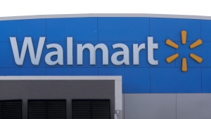 FILE - In this Tuesday, Sept. 3, 2019, file photo, A Walmart logo is attached to the outside of a Walmart store in Walpole, Mass. (AP Photo/Steven Senne, File)