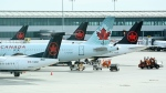 Air Canada planes sit on the tarmac at Pearson International airport during the COVID-19 pandemic in Toronto on Wednesday, Oct. 14, 2020. THE CANADIAN PRESS/Nathan Denette