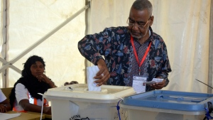 Presidential candidate for Alliance for Change and Transparency, Seif Sharif Hamad, casts his vote in Zanzibar Tanzania, Wednesday. Oct.28, 2020. Tanzania's other top opposition party, ACT Wazalendo, accused police of shooting dead nine people in the semi-autonomous region of Zanzibar. (AP Photo)