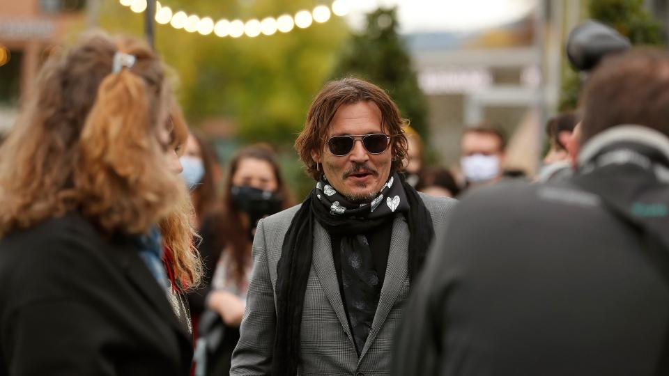 US actor Johnny Depp, centre, arrives at the 16th Zurich Film Festival (ZFF) in Zurich, Switzerland, Friday, Oct. 2, 2020. The festival runs from Sept. 24 to Oct. 4, 2020. (Alexandra Wey/Keystone via AP)