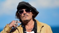 "FILE - In this file photo dated Sunday, Sept. 20, 2020, US actor and film producer Johnny Deep during the photocall for his film ""Crock of Gold: A Few Rounds with Shane Macgoman"" at the 68th San Sebastian Film Festival, in San Sebastian, northern Spain. In a letter to fans, Friday Nov.6, 2020, Depp said he had been ""asked to resign"" from his role in the Fantastic Beasts film franchise, after losing a libel case labelling him a wife beater, a judgement he said he plans to appeal against. (AP Photo/Alvaro Barrientos, FILE)"