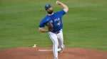 Toronto Blue Jays starting pitcher Robbie Ray throws to a New York Yankees batter during the first inning of a baseball game in Buffalo, N.Y., Wednesday, Sept. 23, 2020. (AP Photo/Adrian Kraus)