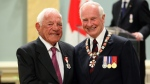 Governor General David Johnston (right) presents the Order of Canada to long time hockey player and commentator Howie Meeker at Rideau Hall in Ottawa on Friday, May 27, 2011. THE CANADIAN PRESS/ Patrick Doyle