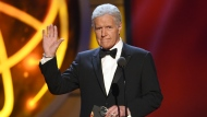 "FILE - This May 5, 2019, file photo shows Alex Trebek gestures while presenting an award at the 46th annual Daytime Emmy Awards in Pasadena, Calif. Jeopardy!"" host Alex Trebek died Sunday, Nov. 8, 2020, after battling pancreatic cancer for nearly two years. Trebek died at home with family and friends surrounding him, ""Jeopardy!"" studio Sony said in a statement. Trebek presided over the beloved quiz show for more than 30 years. (Photo by Chris Pizzello/Invision/AP, File)"
