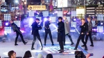 "FILE - Members of BTS perform at the Times Square New Year's Eve celebration in New York on Dec. 31, 2019. The South Korean boy band BTS HAS won a leading four awards including best song for ""Dynamite"" and best group at the MTV Europe Music Awards Sunday, Nov. 8, 2020 while Lady Gaga took home the best artist prize.(Photo by Ben Hider/Invision/AP, File)"