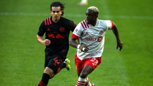 Toronto FC defender Chris Mavinga, right, fights for the ball against New York Red Bulls attacker Brian White during an MLS soccer match, Sunday, Nov. 8, 2020, in Harrison, NJ. (AP Photo/Eduardo Munoz Alvarez)