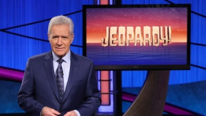 "This image released by Jeopardy! shows Alex Trebek, host of the game show ""Jeopardy!"" The program won outstanding game show at the 47th annual Daytime Emmy Awards. (Jeopardy! via AP)"