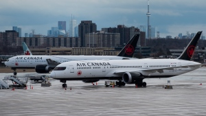 Air Canada airplanes sit on the tarmac at Pearson International Airport in Toronto on Friday, March 20, 2020. (Nathan Denette/The Canadian Press)