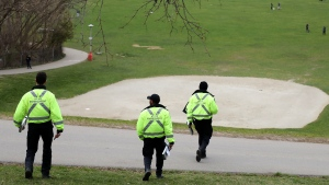 Toronto bylaw officers descend on a park on Friday, April 24, 2020 to enforce COVID-19 rules. THE CANADIAN PRESS/Colin Perkel