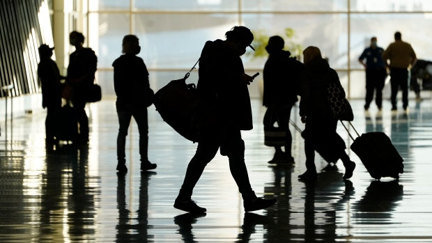 In this Oct. 27, 2020, file photo, passengers walk through Salt Lake City International Airport, in Salt Lake City. Business travel might never look the same in the wake of the coronavirus. Consulting firm McKinsey and Co. says it took international business travel five years to recover after the 2008 recession. But this time, the ease of videoconferencing could put a permanent dent in corporate trips. (AP Photo/Rick Bowmer, File)