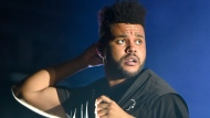 FILE - The Weeknd performs on day three at Lollapalooza in Chicago on Aug 4, 2018. The NFL, Pepsi and Roc Nation announced Thursday, Nov. 12 that the three-time Grammy winner will perform at the 2021 Pepsi Super Bowl Halftime Show on Feb. 7 at Raymond James Stadium in Tampa, Florida. (Photo by Rob Grabowski/Invision/AP, File)