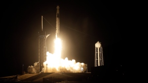 A Falcon 9 SpaceX rocket with the Crew Dragon capsule lifts off from pad 39A at the Kennedy Space Center in Cape Canaveral, Fla., Sunday, Nov. 15, 2020. Four astronauts are beginning a mission to the International Space Station. (AP Photo/Chris O'Meara)