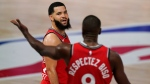 Toronto Raptors' Fred VanVleet, left, talks with teammate Serge Ibaka (9) after Ibaka was called for a technical foul during the second half of an NBA conference semifinal playoff basketball game against the Boston Celtics Monday, Sept. 7, 2020, in Lake Buena Vista, Fla. (AP Photo/Mark J. Terrill)