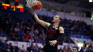 San Diego State guard Malachi Flynn (22) drives to the rim for a basket against Air Force in the second half of an NCAA college basketball game Saturday, Feb. 8, 2020, at Air Force Academy, Colo. (AP Photo/David Zalubowski)