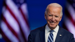 In this Nov. 10, 2020, file photo President-elect Joe Biden smiles as he speaks at The Queen theater in Wilmington, Del. President-elect Biden turns 78 on Friday, Nov. 20. (AP Photo/Carolyn Kaster, File)
