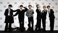 "Members of South Korean K-pop band BTS pose for photographers during a press conference to introduce their new album ""BE"" in Seoul, South Korea, Friday, Nov. 20, 2020. K-pop band BTS has released their highly anticipated new album, which they describe as a ""letter of hope."" (AP Photo/Lee Jin-man)"
