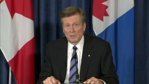 Mayor John Tory speaks with reporters at Toronto City Hall Friday, November 20, 2020.
