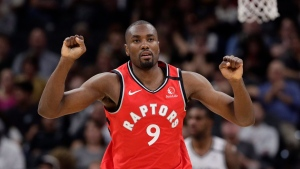 Toronto Raptors center Serge Ibaka (9) reacts after scoring against the San Antonio Spurs during the second half of an NBA basketball game in San Antonio, Sunday, Jan. 26, 2020. (AP Photo/Eric Gay)