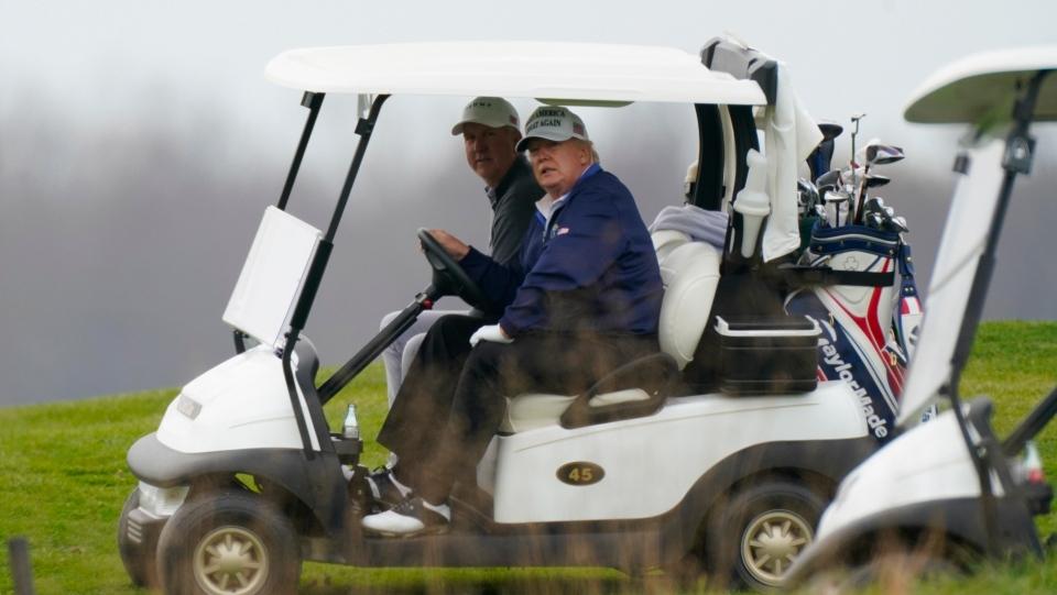 President Donald Trump drives a golf cart as he golfs at Trump National Golf Club in Sterling, Va., Sunday, Nov. 22, 2020. (AP Photo/Manuel Balce Ceneta)