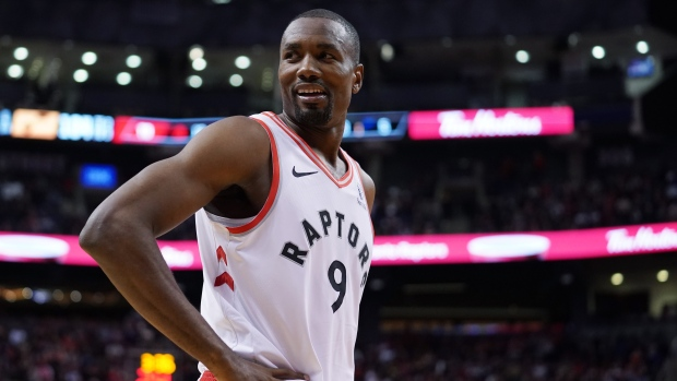 Toronto Raptors' Sege Ibaka (9) reacts during second half NBA basketball action against the Utah Jazz in Toronto, Sunday, Dec. 1, 2019. THE CANADIAN PRESS/Hans Deryk