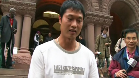 Wang Chen, who owns the Lucky Moose Food Mart, is seen outside of the Old City Hall Courts on Thursday, Oct. 22, 2009.