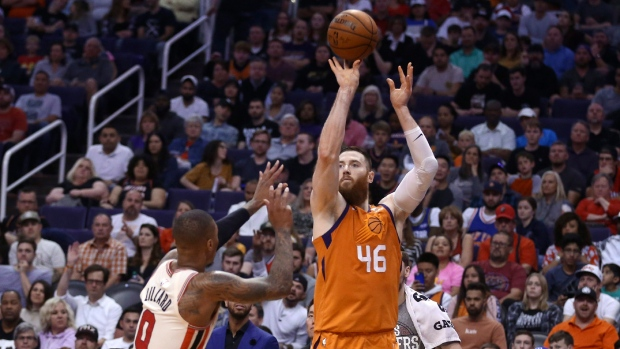 Phoenix Suns center Aron Baynes (46) shoots a 3-pointer over Portland Trail Blazers guard Damian Lillard (0) during the second half of an NBA basketball game Friday, March 6, 2020, in Phoenix. (AP Photo/Ross D. Franklin)