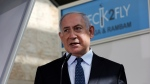 In this Nov. 9, 2020, file photo, Israeli Prime Minister Benjamin Netanyahu visits a new coronavirus lab at Ben-Gurion International Airport, near Tel Aviv, Israel. Israeli media reported Monday, Nov. 23, 2020 that Netanyahu flew to Saudi Arabia for a clandestine meeting with Crown Prince Mohammed bin Salman, which would mark the first known encounter between senior Israeli and Saudi officials. (Ohad Zwigenberg/Pool Photo via AP, File)