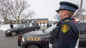 "Ontario Provincial Police Sergeant Tom Valtonen salutes as the hearse carrying OPP Const. Marc Hovingh leaves Toronto en route back to Manitoulin Island on Monday, November 23, 2020. Hovingh was one of the officers who responded to a call regarding an ""unwanted man'' on a property in Gore Bay, Ontario. THE CANADIAN PRESS/Frank Gunn"