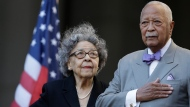 "In this Oct. 15, 2015, file photo, former New York City Mayor David Dinkins, right, and his wife, Joyce Dinkins, stand at attention as they listen to "" The Star-Spangled Banner,"" during a ceremony renaming the Manhattan Municipal Building to the David N. Dinkins Building, in New York. David Dinkins was New York City's first Black mayor, serving from from 1990 to 1993. Joyce Dinkins, 89, died Sunday, Oct. 11, 2020, according to her family. (AP Photo/Mary Altaffer, File)"