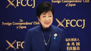 Tokyo Gov. Yuriko Koike arrives for a news conference in Tokyo, Tuesday, Nov. 24, 2020. Koike remains firm about being able to safely hold the Olympics next year despite growing concerns about Japan's recent resurgence of COVID-19 infections. (AP Photo/Koji Sasahara)