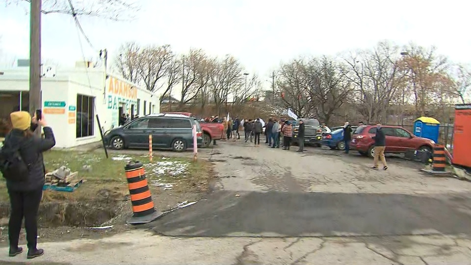 Customers are shown outside Adamson Barbecue's Etobicoke location on Tuesday.
