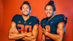 University of Illinois players Sydney Brown (30), Chase Brown (2), identical twin brothers from London, Ont., pose in this undated handout photo. THE CANADIAN PRESS/HO - Illinois Athletics, Michael Glasgow